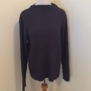 High neck/boat neck sweater.